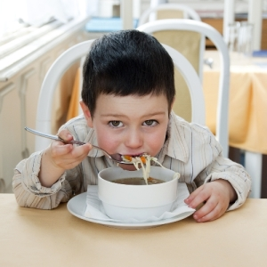 boy eating soup small